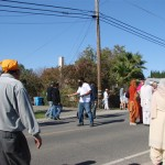 Sikh Giving volunteers distributing brochures